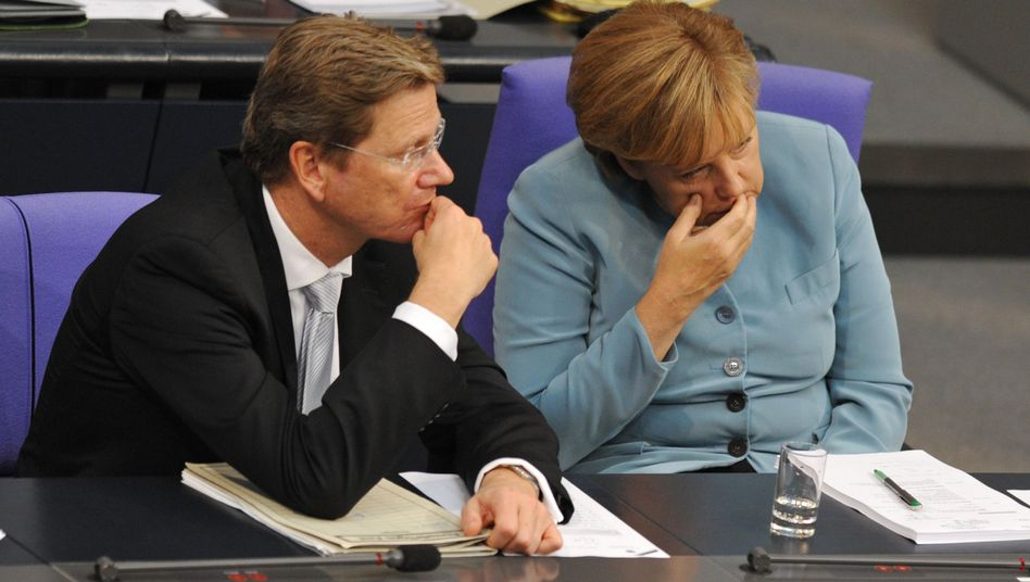 Chancellor Angela Merkel and Foreign Minister Guido Westerwelle, the leader of the FDP, face election setbacks in 2011.