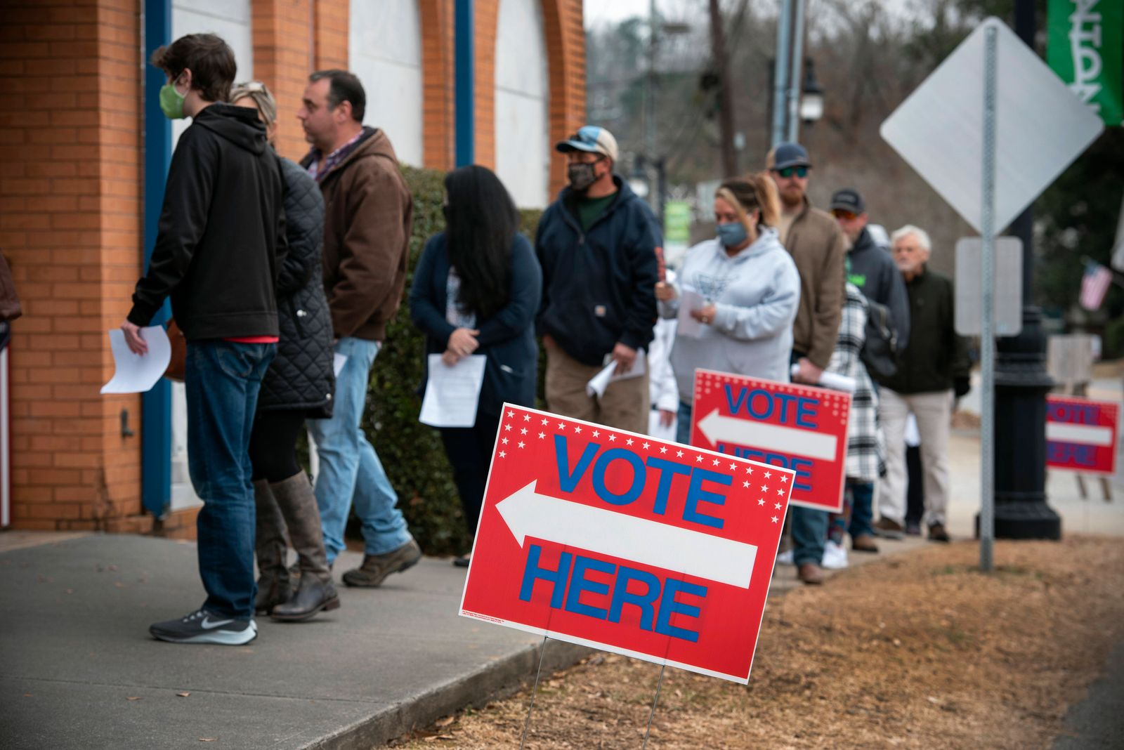 December 30, 2020, Canton, GA, USA: Early voters in North Georgia brasher the damp cold to queue for more than an hour