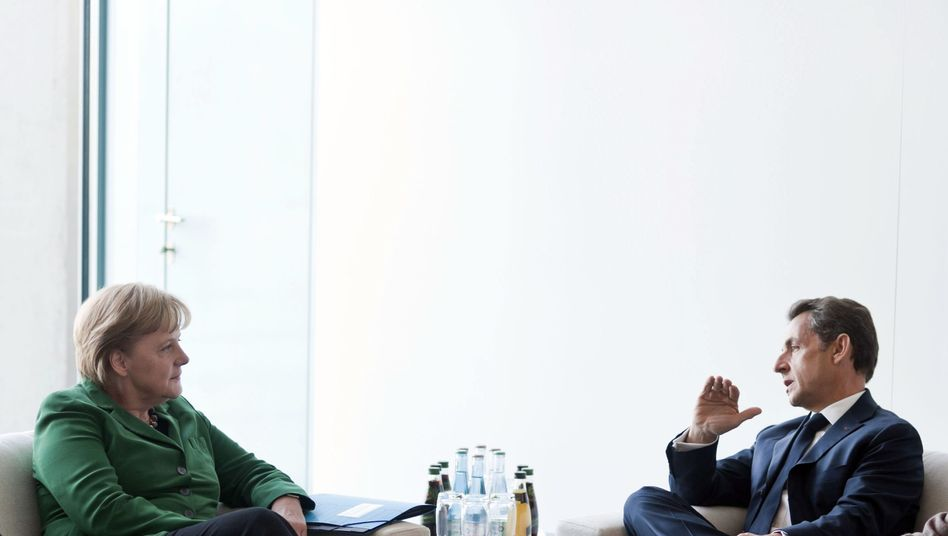 Kanzlerin Merkel und Staatspräsident Sarkozy in Berlin: Demonstrative Geschlossenheit