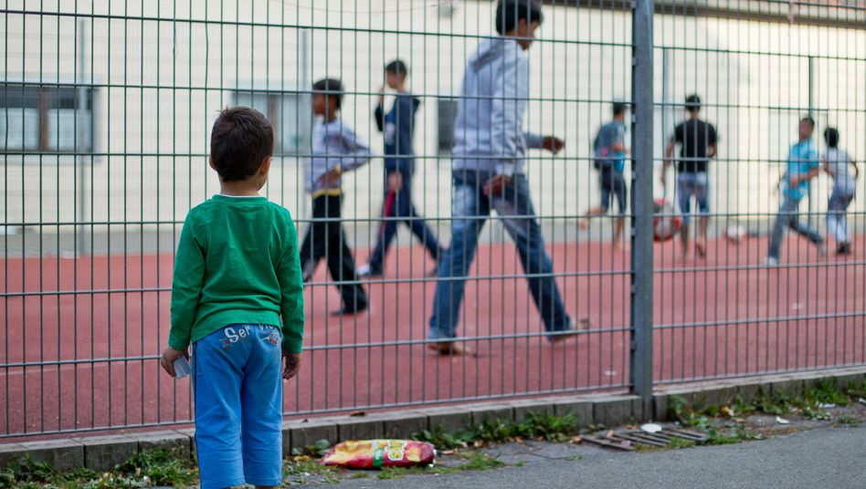 Children of asylum-seekers play football at a refugee reception center in Zirndorf, Bavaria, in this 2012 archive photo.