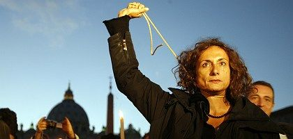 Italian transgender and former communist lawmaker Vladimir Luxuria mimics a hanging outside St. Peter's Square at the Vatican: Gay and transgender rights activists are outraged by the pope's statements.