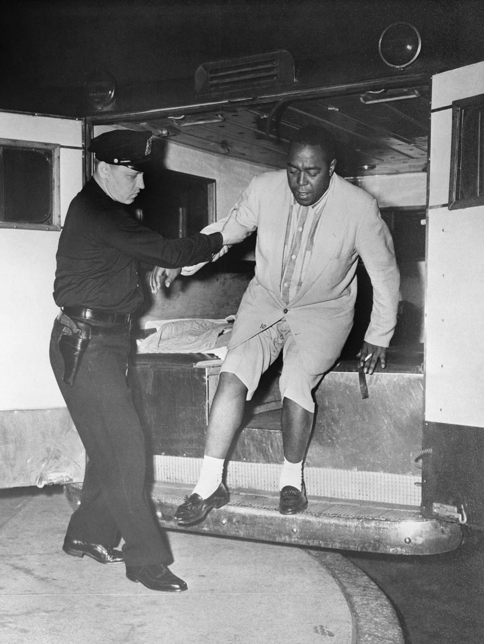 Police Officer Helping Charlie Parker from Ambulance