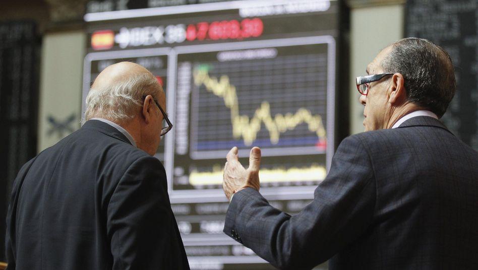 Fallende Kurse in der Börse in Madrid: Bonität des Landes herabgestuft