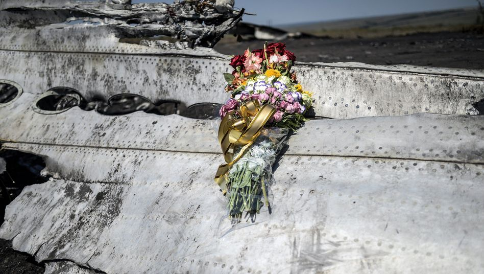 Flowers on a piece of wreckage from MH17.