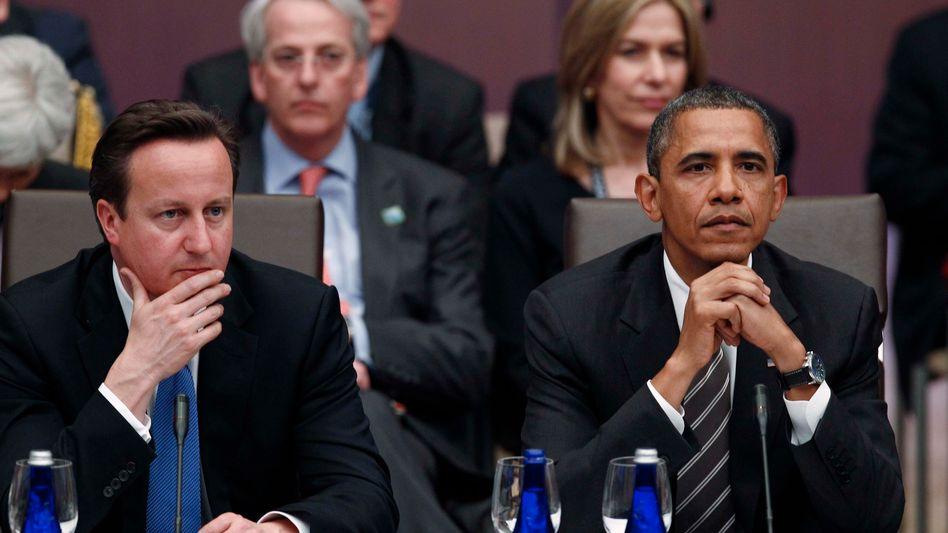 Cameron (l.), Obama: Dringender Appell an Angela Merkel