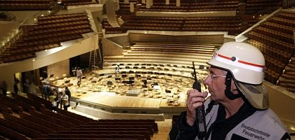 A fire official inside Berlin's Philharmonic the day after the landmark building caught fire.