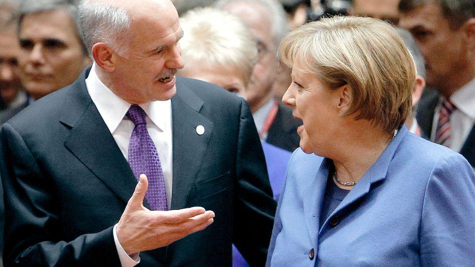 Griechischer Premier Papandreou und Kanzlerin Merkel: Einladung an Spekulanten