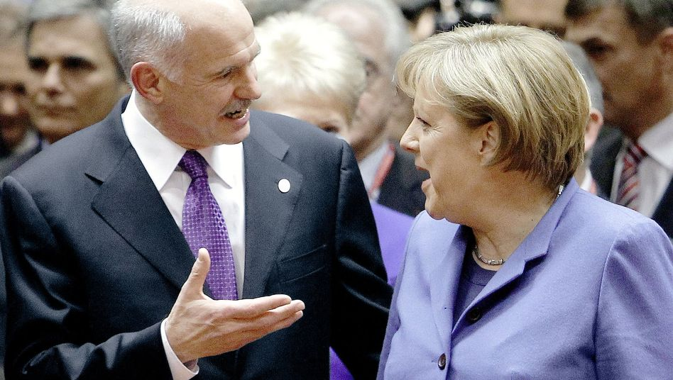 Greek Prime Minister George Papandreou talks with German Chancellor Angela Merkel at an EU summit in Brussels on March 25.