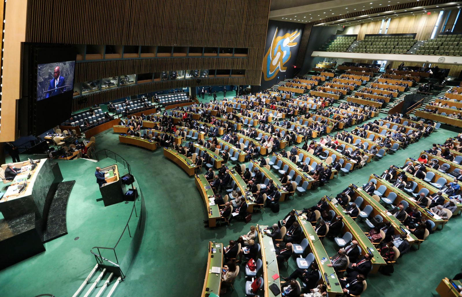 (210921) -- UNITED NATIONS, Sept. 21, 2021 -- Abdulla Shahid (at the podium and on the screen), president of the 76th s