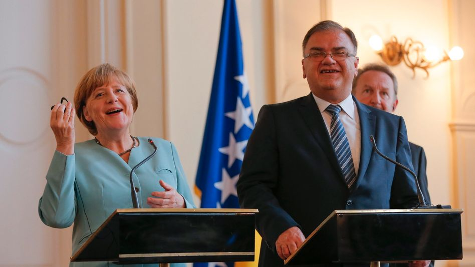 Kanzlerin Merkel und der Vorsitzende des Präsidentenrates Ivanic: Friedliches Zusammenleben wichtig