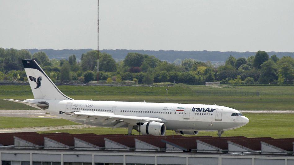 A file photo of an Iran Air plane at Orly Airport in Paris: With oil giants afraid to sell fuel to the airline, it is forced to conduct fuel stops on many of its flights from Europe.