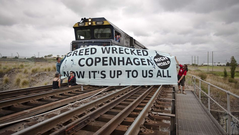 Climate change protestors hold up a banner in Newcastle Port, Australia on Saturday, following the failure of the UN global summit in Copenhagen.