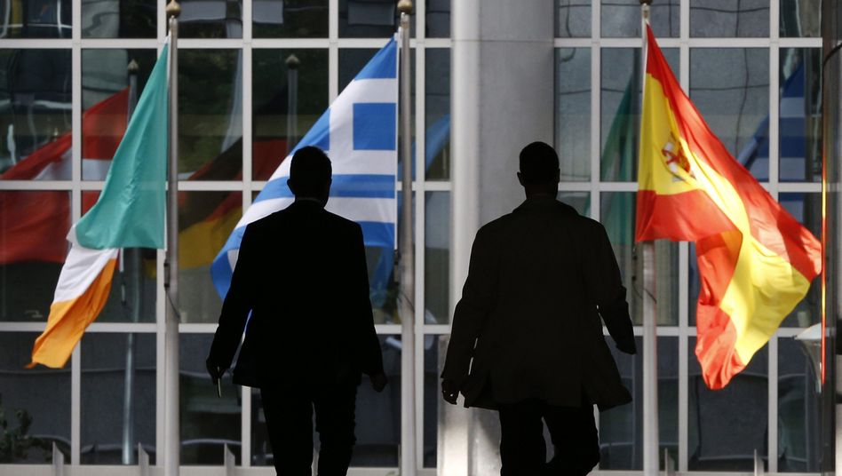 The Irish, Greek and Spanish flags flying in Brussels. Berlin's euro-zone partners are growing weary of its Greece tactics.