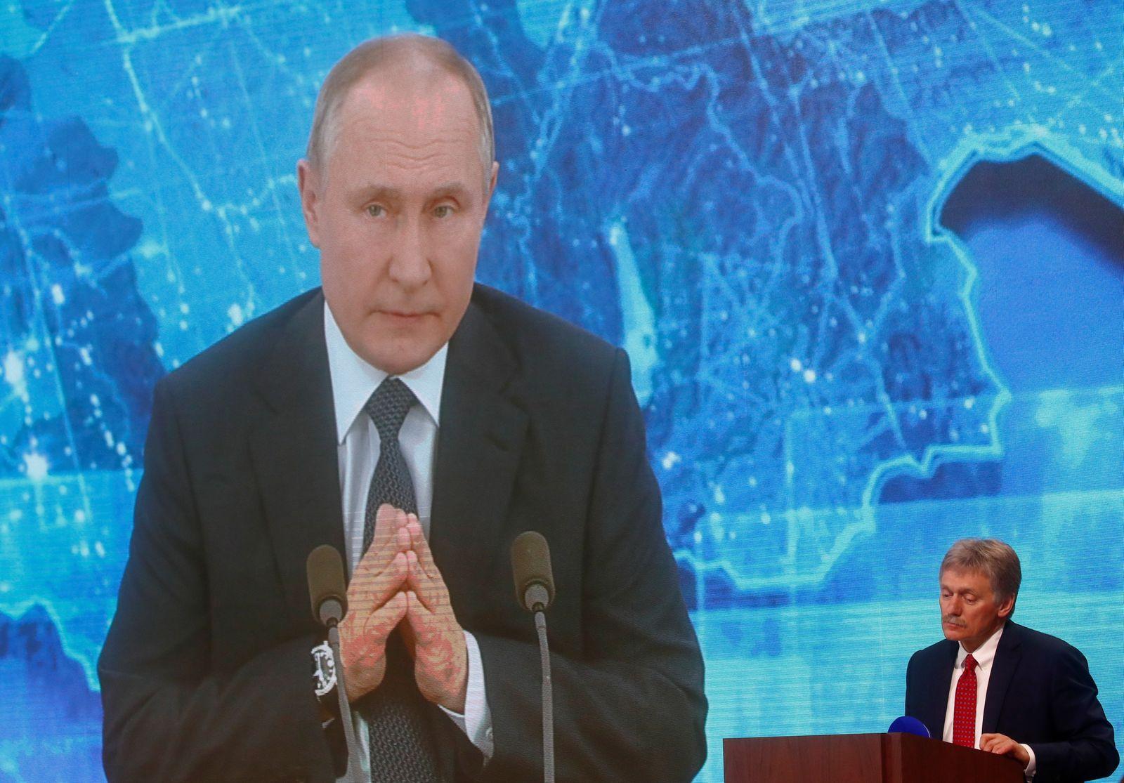 Kremlin spokesman Dmitry Peskov attends President Vladimir Putin's annual end-of-year news conference in Moscow