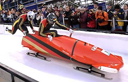 Christoph Langen, right, and Markus Zimmerman of Germany in GER-1, push off during the two-man Men's Bobsled at the Salt Lake City Winter Olympics in Park City, Utah, Saturday, Feb. 16, 2002.