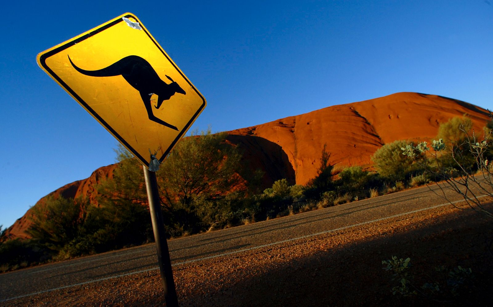 File photo of a road sign near Uluru (Ayers Rock), about 350 km (217 miles) southwest of the central Australian town of Alice Springs