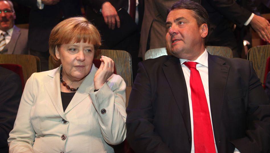 Kanzlerin Merkel, SPD-Chef Gabriel: Woher soll das Geld kommen?