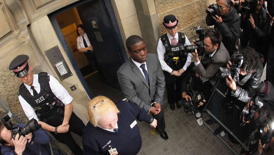 UBS trader Kweku Adoboli, shown leaving a London court on Sept. 22, allegedly made unauthorized trades that cost the Swiss investment bank billions.