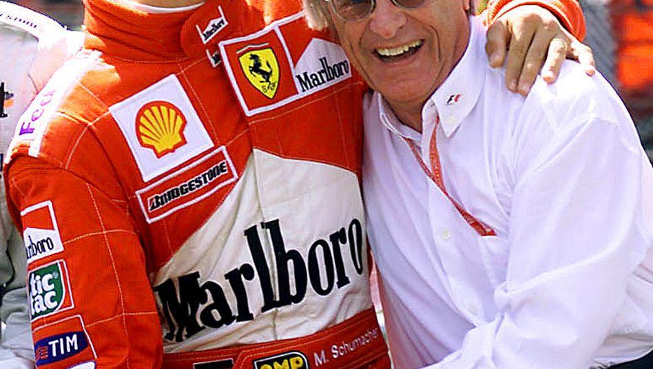 Bernie Ecclestone (2009 mit Michael Schumacher)