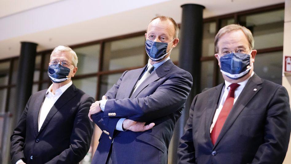 Rivalen Laschet, Röttgen, Merz in Berlin:Die Risse verlaufen quer durch die CDU
