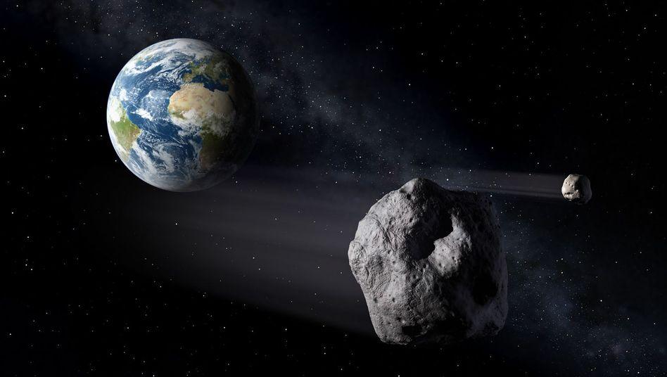 Asteroid im Anflug auf die Erde (künstlerische Darstellung)