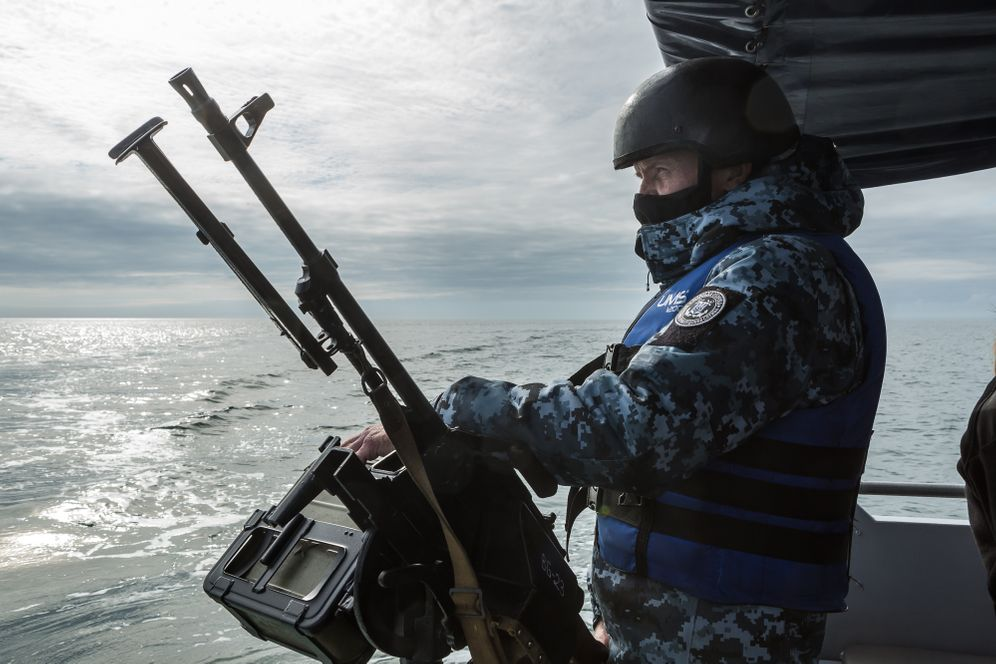 A Ukrainian soldier on a ship in the Sea of Asov