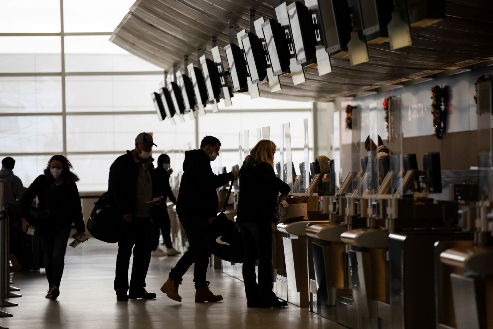 FILE PHOTO: People travel during the holiday season at Detroit Metropolitan Wayne County Airport