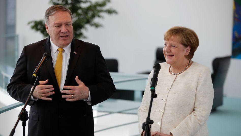 Angela Merkel und Mike Pompeo wollen vor ihrem Gespräch keine Zeit verlieren