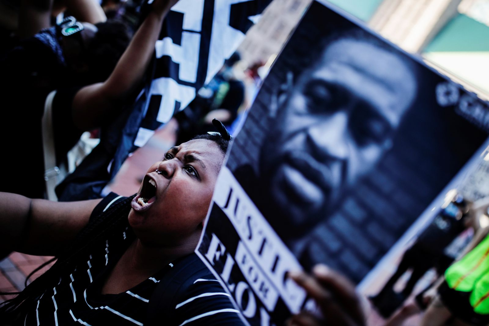 A protester reacts while gathering with others outside the city hall in Minneapolis