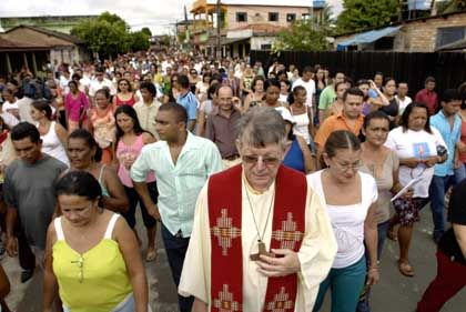Erwin Kräutler leads an Easter procession in Altamira. The bishop is always escorted by bodyguards after receiving death threats.