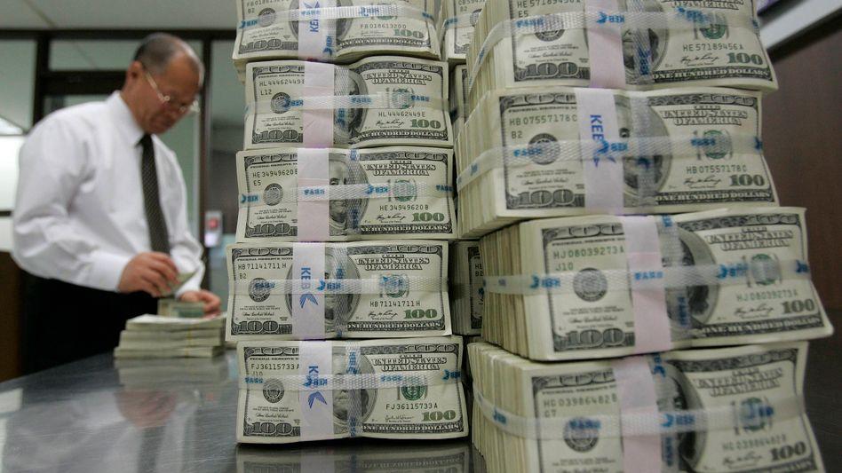 Dollar-Noten: Warnung vor einer neuen Währungskrise