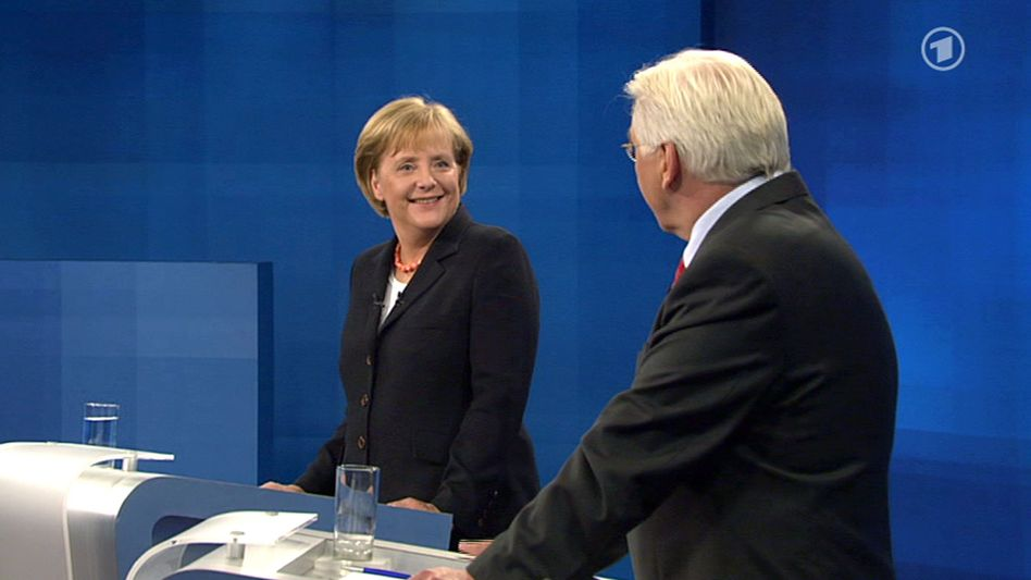 All smiles: German Chancellor Angela Merkel and Foreign Minister Frank-Walter Steinmeir at their only televised political debate on Sunday before the election on Sept. 27.