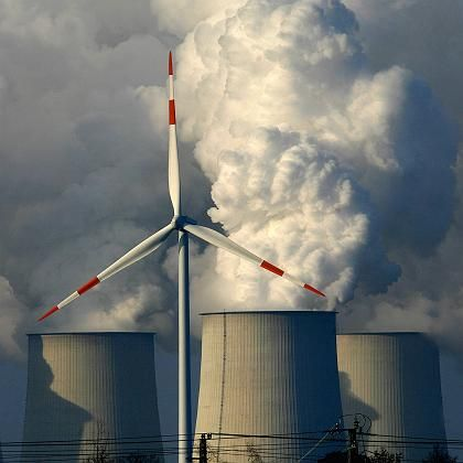 A wind turbine in front of a coal-burning power facility in the eastern German state of Brandenburg.