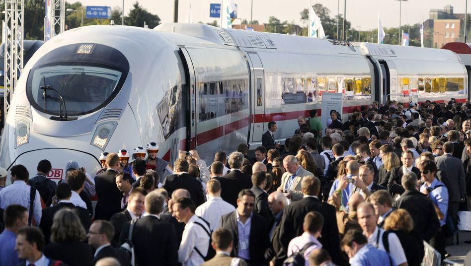 Visitors inspect the new Siemens Velaro train at the InnoTrans 2010 trade fair in Berlin. Will the German high-speed train soon be whisking passengers from Tampa to Disney World?