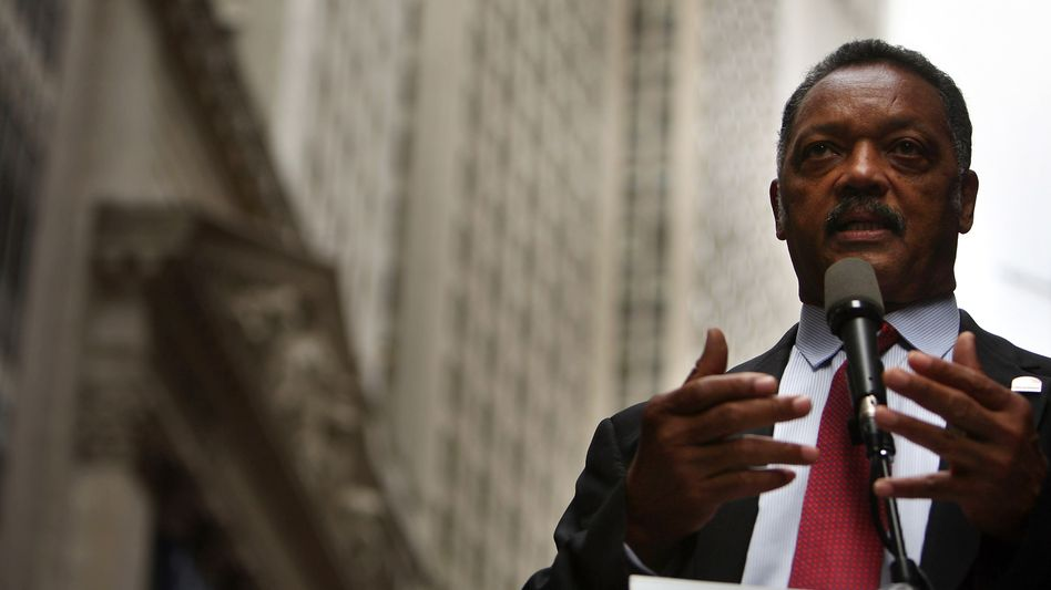 Rev. Jesse Jackson, a Democrat, speaks near Wall Street in a file photo.