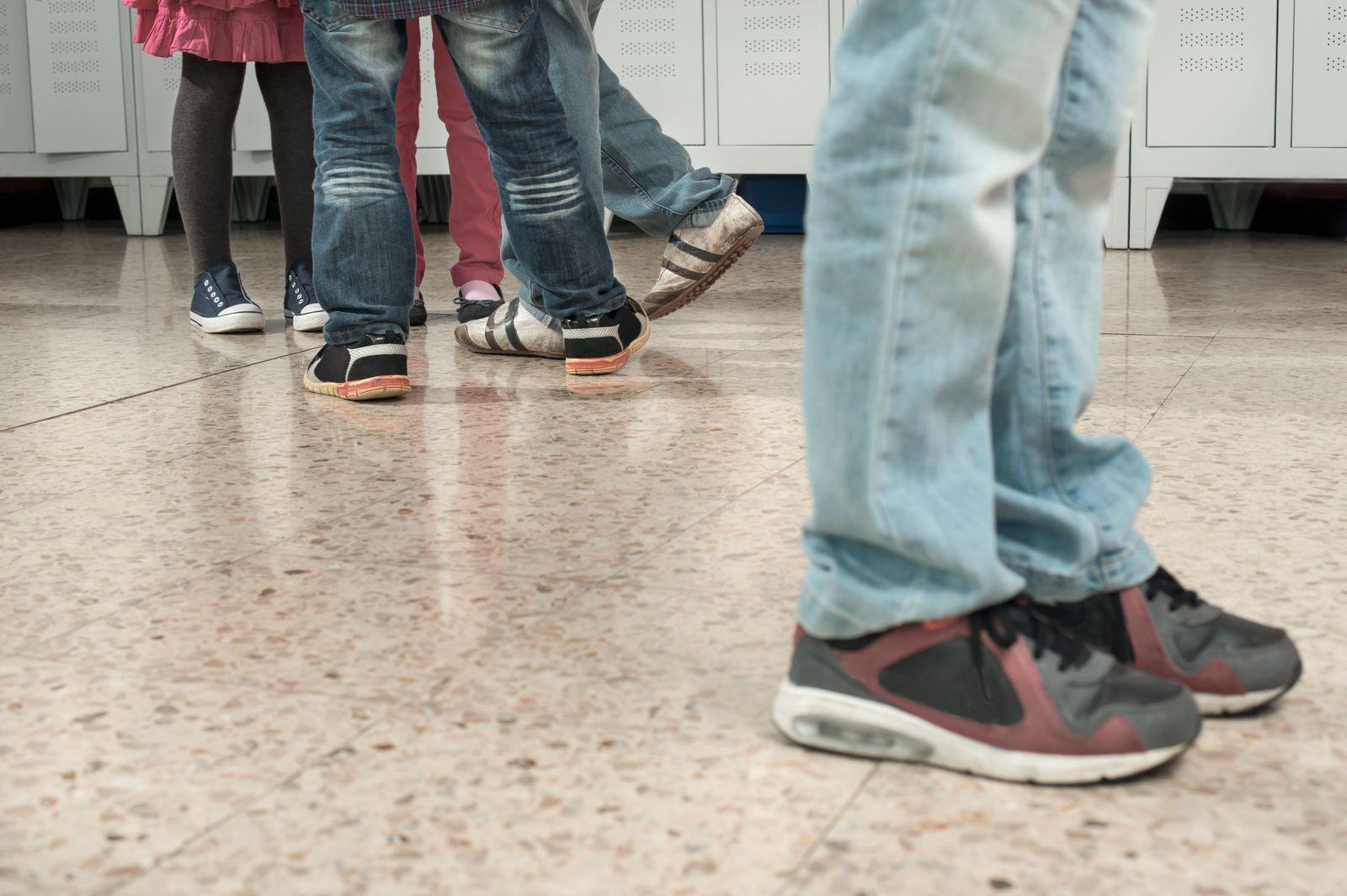 Schoolboy being bullied by his classmates in school, Bavaria, Germany