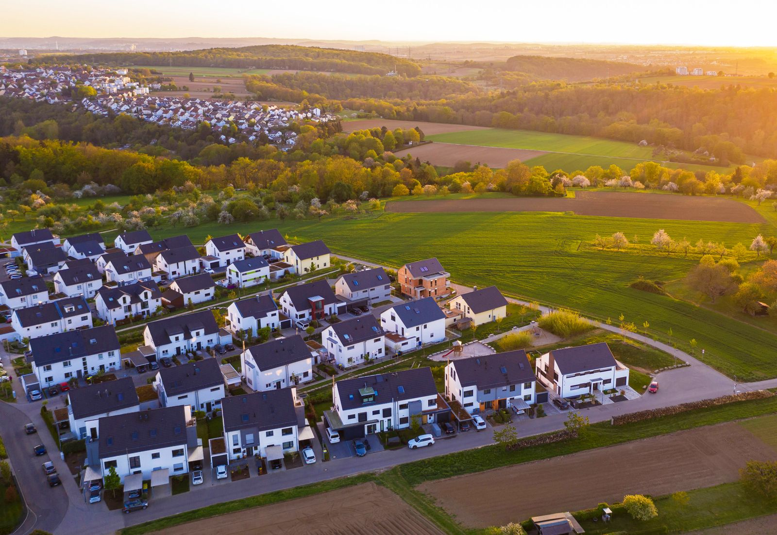 Germany, Baden-Wurttemberg, Waiblingen, Aerial view of modern suburb at sunset WDF06042