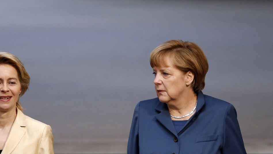 Despite sharing a party, German Labor Minister Ursula von der Leyen (left) and Chancellor Angela Merkel do not share views on gender quotas for supervisory boards.