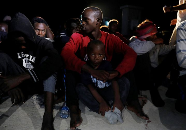 The number of migrants making the voyage across the sea to Europe has fallen dramatically in recent years, from 1 million in 2015, to about 58,000 in the first seven months of 2018. Shown here: Migrants at a naval base after being intercepted by the Libyan coast guard near Tripoli, Libya.