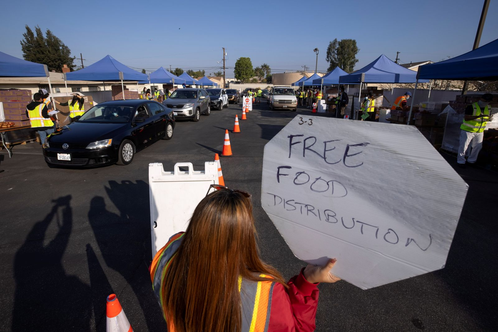 Cars line-up as the Los Angeles Regional Food Bank distributes food outside a church during the outbreak of the coronavirus disease (COVID-19) in Los Angeles