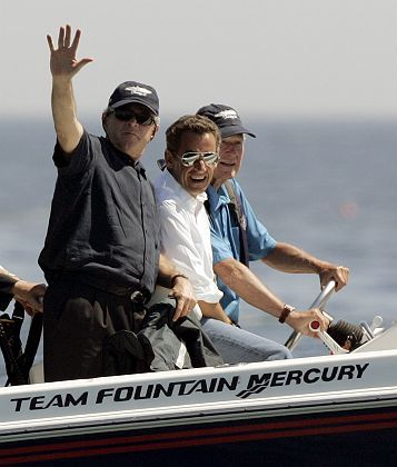 """Former US President George H.W. Bush (right) takes US President George W. Bush (left) and French President Nicolas Sarkozy for a boat ride in the waters off Kennebunkport, Maine. """"Our foreign policy is no longer based on anti-Americanism,"""" Kouchner says. """"We are friends and allies of the United States, but not vassals."""""""