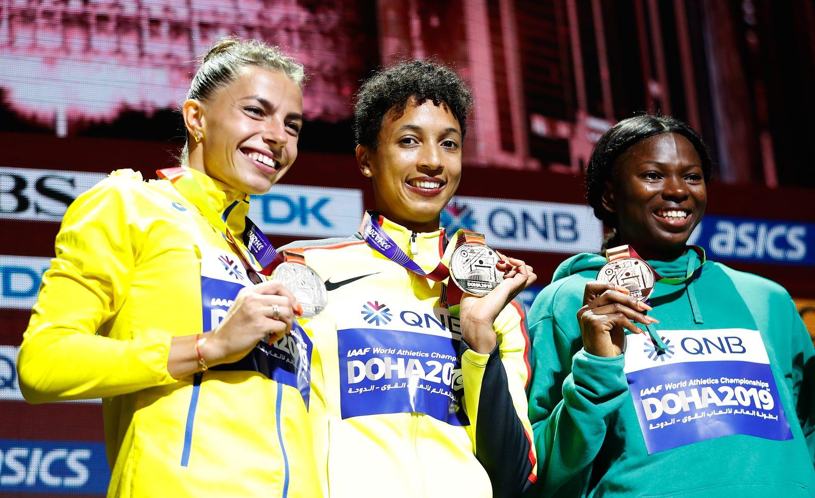 (191007) -- DOHA, Oct. 7, 2019 -- Silver medalist, Maryna Bekh-Romanchuk of Ukraine, gold medalist, Malaika Mihambo of G