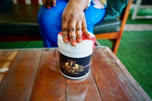 A peeling product that is sold by Farcadi. It is visible on her hands that she has used bleaching products. Most people retain dark knuckles and elbows.