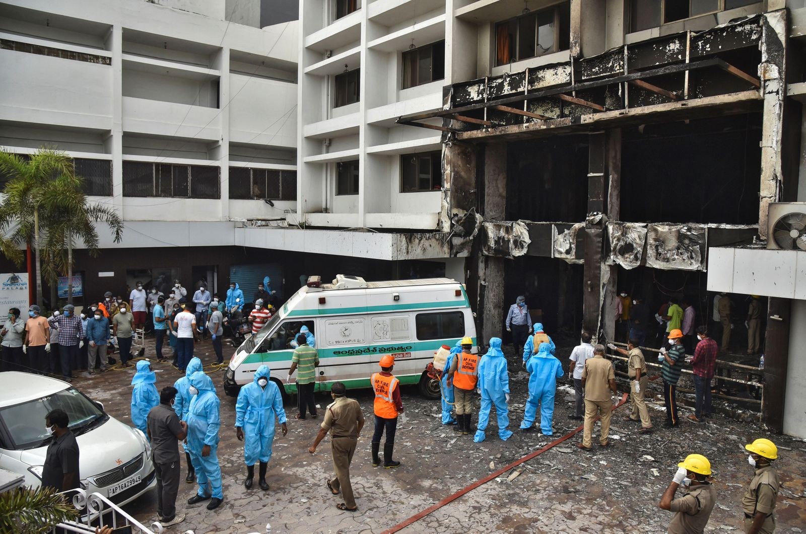 Rescue workers look for survivors after a fire broke out in a hotel that was being used as a COVID-19 facility in Vijayawada