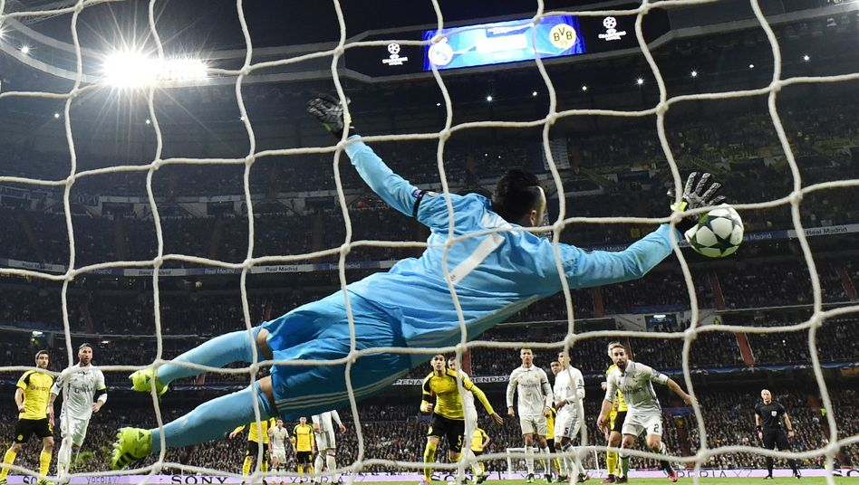 Real Madrid's keeper Keylor Navas making a save against Dortmund