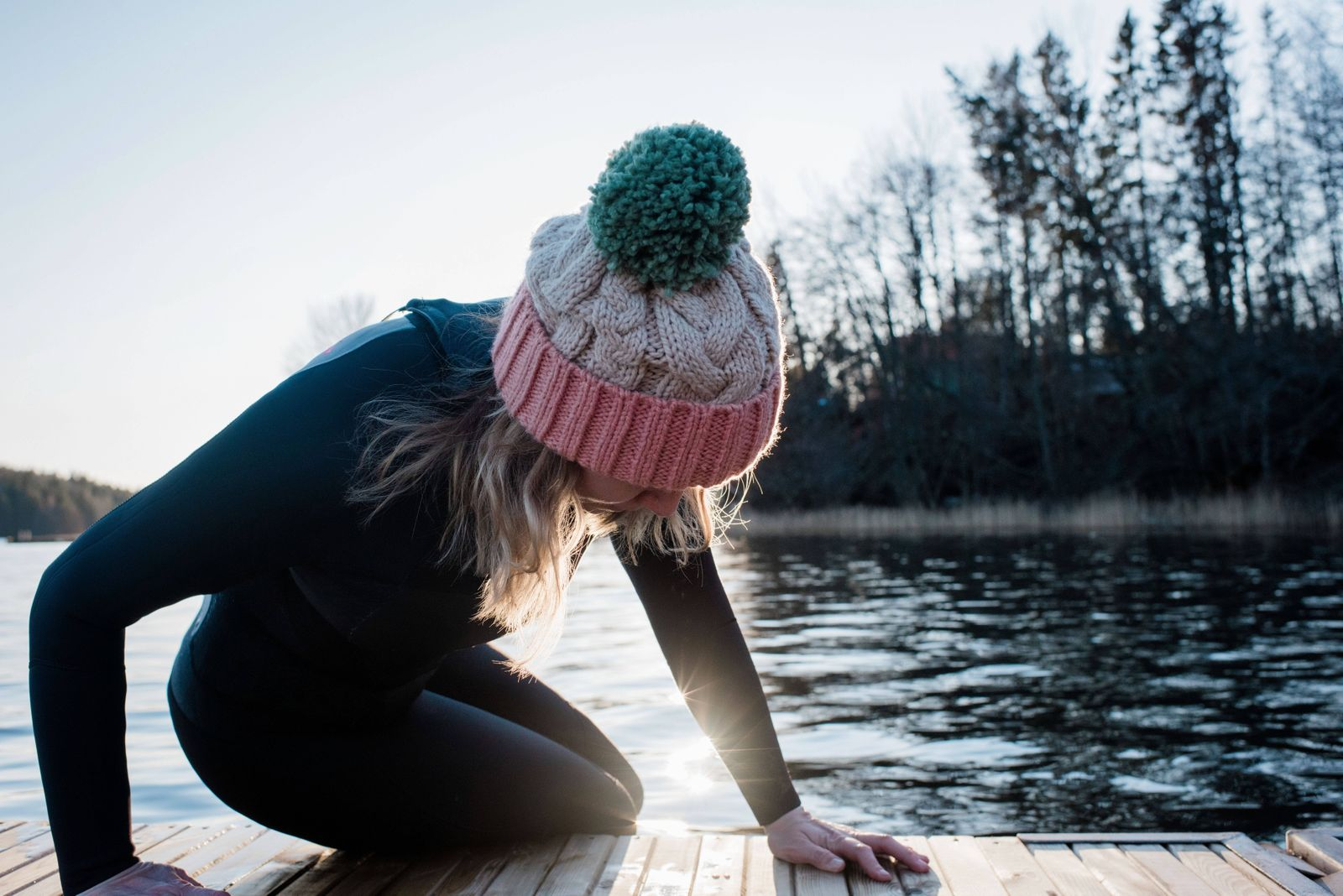woman climbing out of the water from cold water ice swimming in Sweden Norrto¤lje, Stockholm County, Sweden ,model rele
