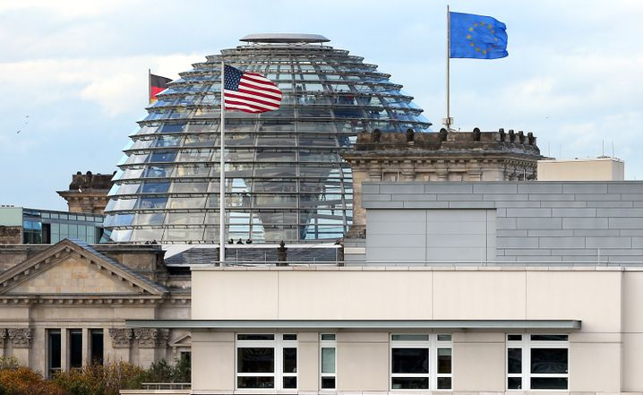 The roof of the US Embassy in Berlin appears in the foreground, with the cupola of the German parliament building, the Reichstag, in the background. It is believed the US conducted esponiage from its Berlin Embassy.