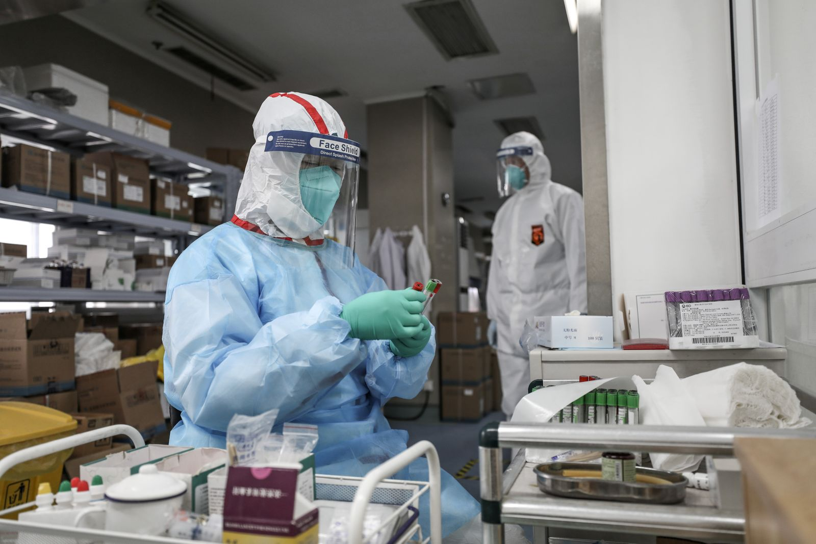 Medical worker in protective suit prepares for an RNA test at Jinyintan hospital in Wuhan, the epicentre of the novel coronavirus outbreak
