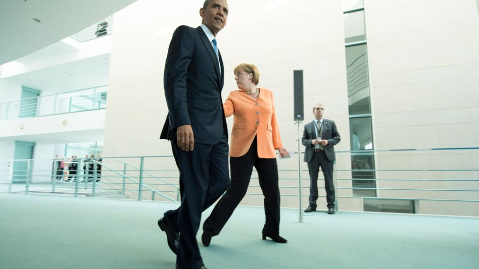 US President Barack Obama and Chancellor Angela Merkel during the American leader's visit to Berlin: Germany may break a taboo by spying back.