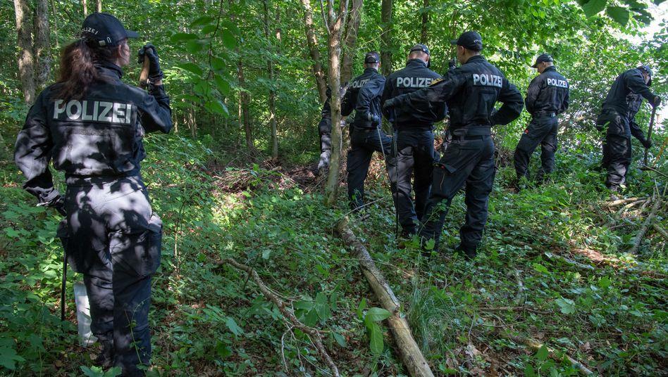 Sucheinsatz der Polizei in einem Waldstück bei München